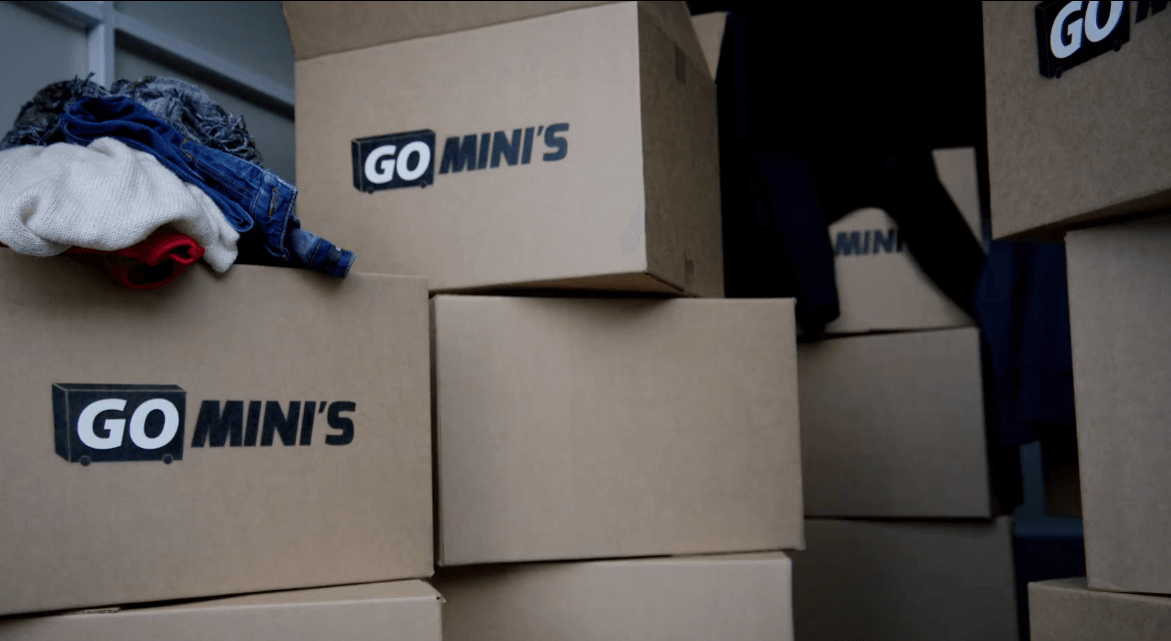 A stack of Go Mini's moving boxes inside a storage container