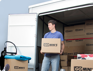 Man loading a Go Mini's container with boxes