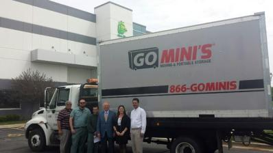 Happy clients in front of Go Mini's truck
