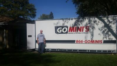 man in front of go minis on lawn