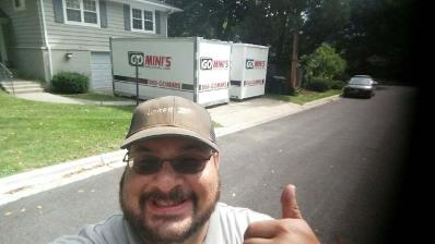 thumbs up man in front of go minis unit