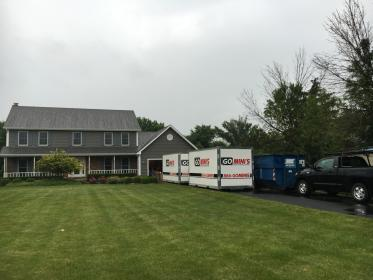 two go minis units on driveway with truck