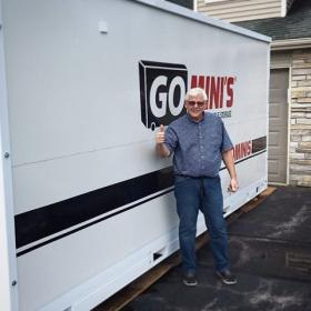man in front of go minis unit