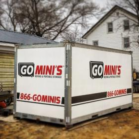 go minis unit on driveway with garage