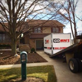go minis unit on driveway with truck
