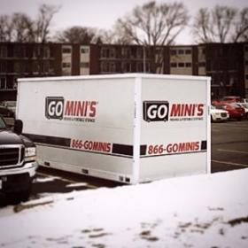 go minis unit in parking lot with snow