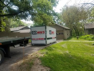 go minis unit on driveway with lawn and truck